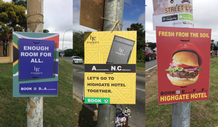 Hotel political posters on street poles