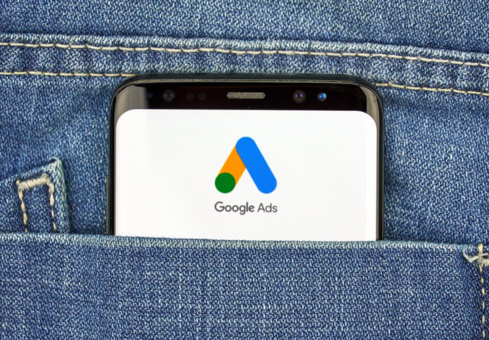 Smartphone in pocket with Google Ads logo
