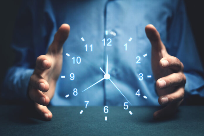 Hands holding struture-less clock