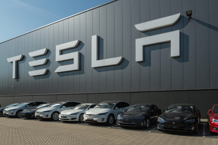 Tesla Factory with Tesla cars lined up outside