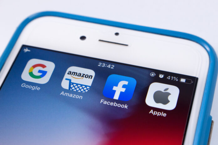 Smartphone screen showing Google, Apple, Amazon and Facebook apps