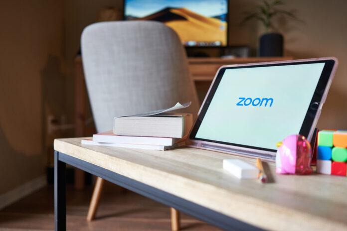 Tablet showing Zoom logo
