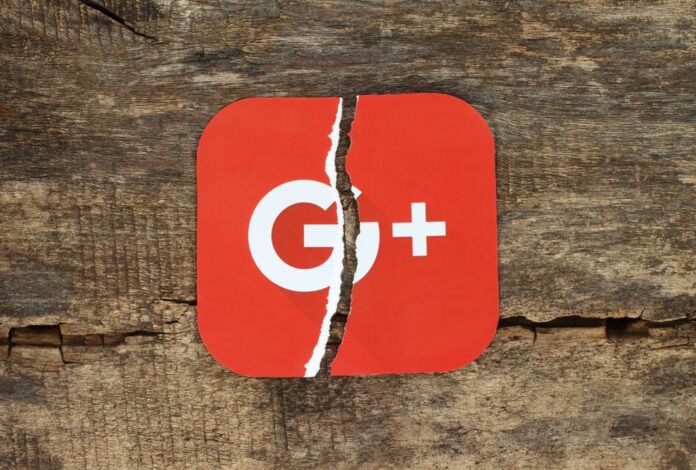 Torn red card with Google+ logo