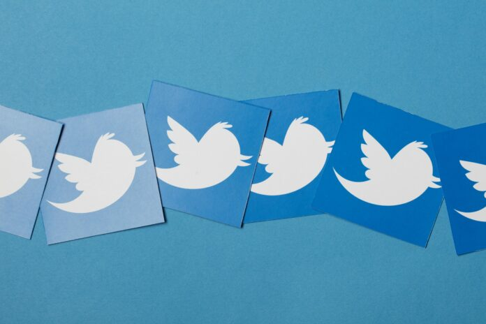 6 cards with Twitter logos with varying blue background colours