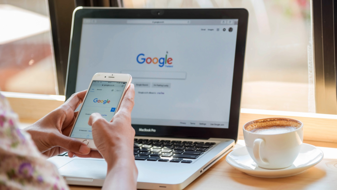 Google search on smartphone and MacBook Pro
