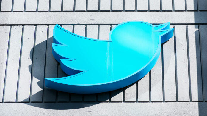 Twitter logo against side of building