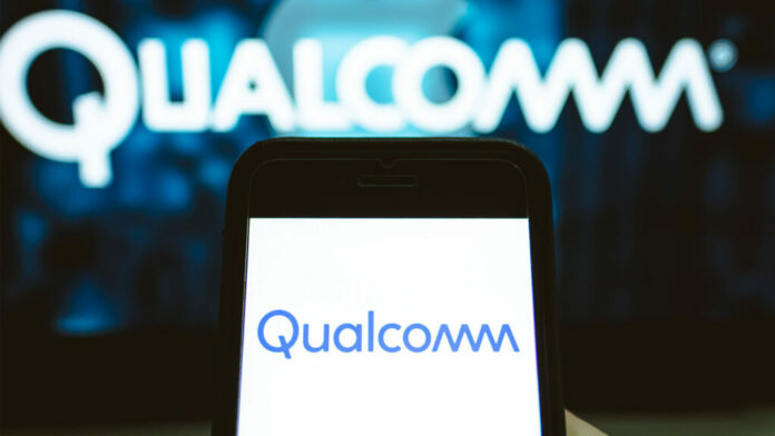 Smartphone with Qualcomm logo on screen and logo in background