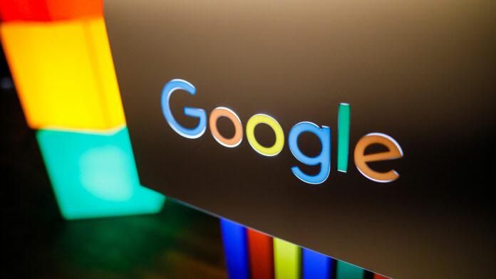Google logo on black background with colourful lighting
